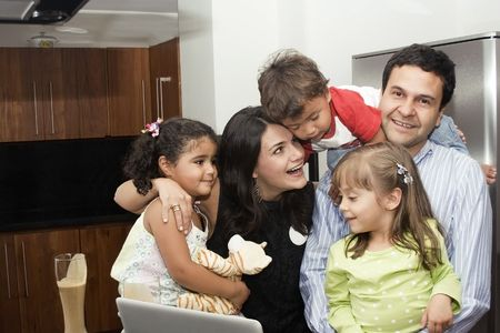Portrait of beautiful family cooking in kitchen, dad, mom, daughters and little boy photo