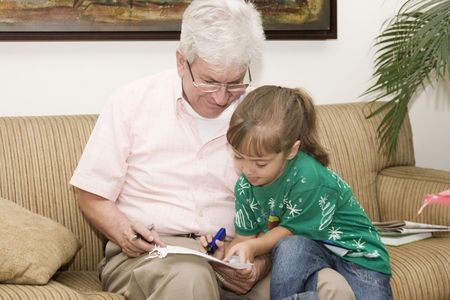 grandchild: Portrait of family, grandfather enjoying with his granddaughter indoor
