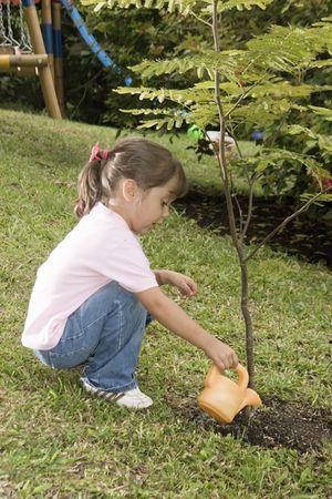 Little girl having gardening time outside photo