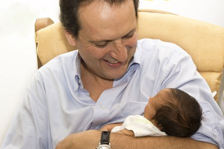 Portrait of family, father playing with his newborn baby photo