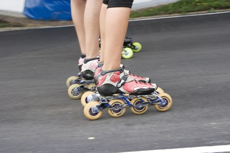 Skater in competitition on roller skates photo