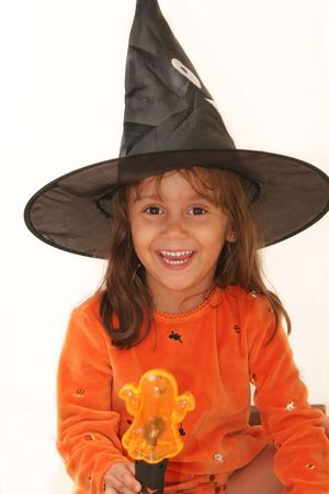 Young girls dressed up in costumes, trick or treating on Halloween photo