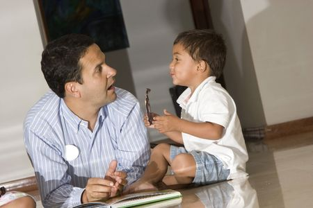 Portrait of family, father and son enjoying at home Stock Photo