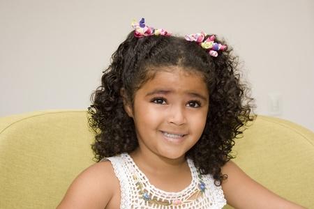 Portrait of Addorable Happy Beautiful Little Girl photo