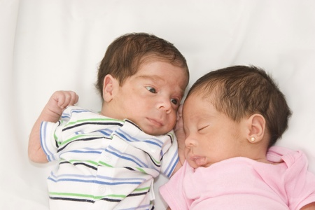 Portrait of twin babies boy and girl photo