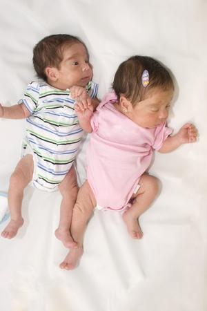Portrait of twin babies boy and girl photo