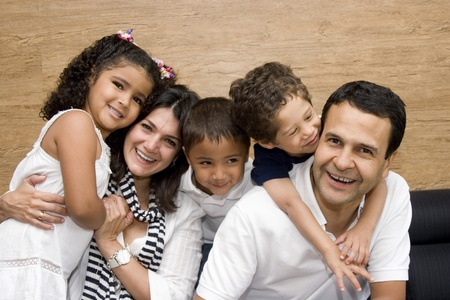 Beautiful family enjoying, mom and dad playing with their children at home Stock Photo - 10909711