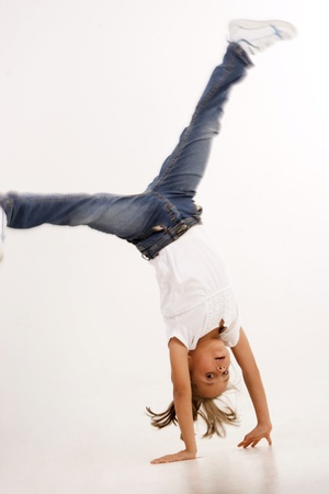 agility people: Beautiful Girl Enjoying Doing Cartwheel, Hand Stand Stock Photo