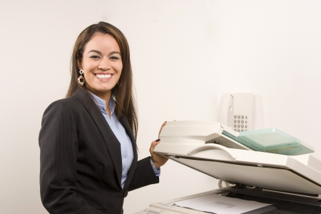 photocopy: Young young businesswoman making copies on the photocopy machine at the office Stock Photo