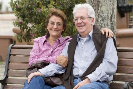 Happy Senior Couple In The Park Otdoor Stock Photo - 14308565