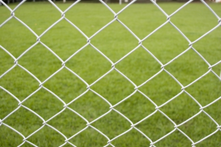 delimit: Seamless Wire Fence With Green Field Background Stock Photo
