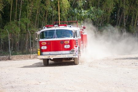 A Shiny Red Fire Truck In Action, In Motion photo