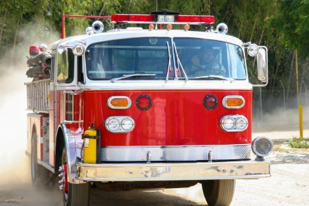 sirens: A Shiny Red Fire Truck In Action, In Motion Stock Photo