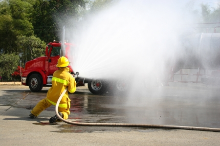 public safety: Firefighter fighting For A Fire Attack, During A Training Exercise Stock Photo