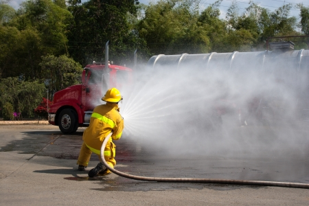 Firefighter fighting For A Fire Attack, During A Training Exercise photo