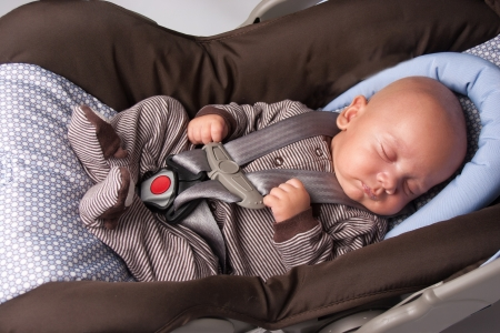 Adorable Little Girl Eating Yogurt  Baby Boy Sleeping In Safety Seat photo