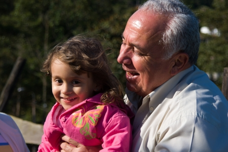 Happy Grandfather and grandchild, Enjoying At The Park photo