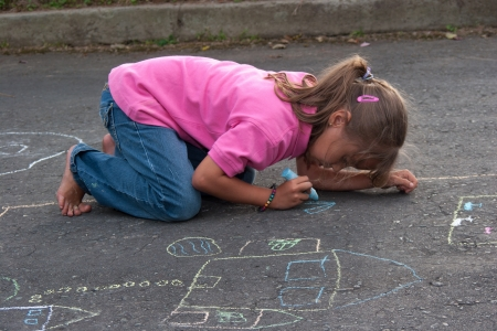 indian student: Portrait of Beautiful Little Girl Painting Outdoors Stock Photo