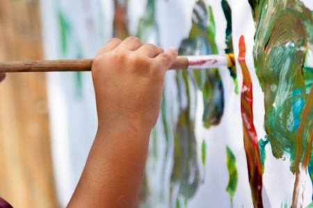 children painting: Little Child Painting With  Brush Stock Photo
