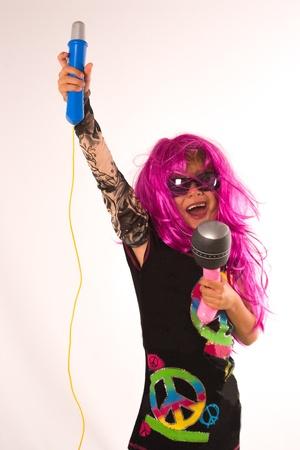 Portrait of Beautiful Rock Star Gilr Singing