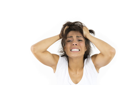 Worried Woman Over White Background Stock Photo