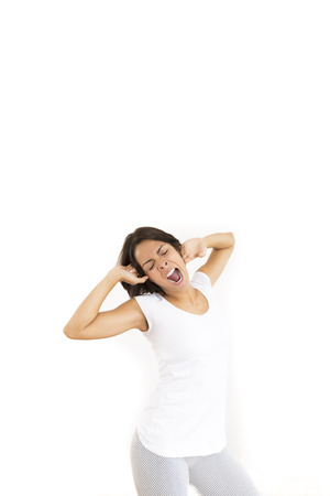 unwinding: Portrait of Tired Young Woman Over White Background Stock Photo