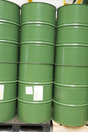 stacked up: Green barrels or chemical drums stacked up Stock Photo