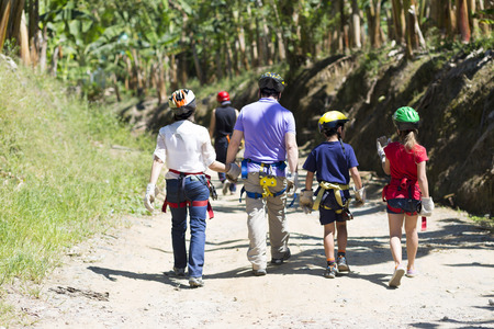 dada: Family Adventure Vacations  Trekking in Forest Stock Photo