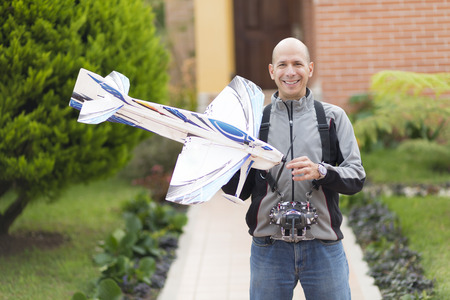model airplane: Happy Man Enjoying Model Airplane Outdoors In Summer