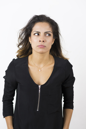 gasping: Portrait of Angry Young Woman Over White Background