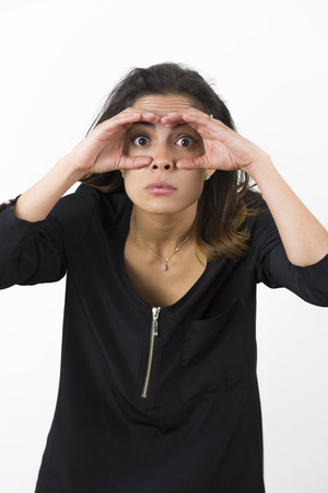 observant: Young Beauty Woman Making Binoculars With Hand Stock Photo
