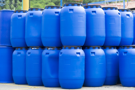 water storage barrel chemical plant plastic storage drums big blue barrels stock photo - Water Storage Barrels