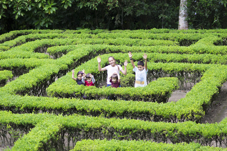 Happy Children Playing at Garden Labyrinth
