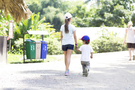Happy Girl and Boy Walking in the Park photo