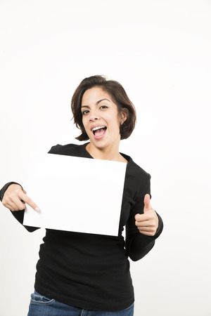 white sheet: Beautiful young woman holding a blank sheet of paper. Space for your text. Isolated on white.