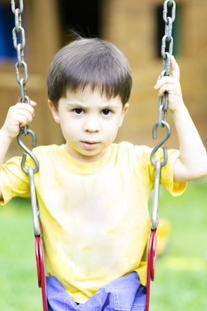 Happy children swinging in the park