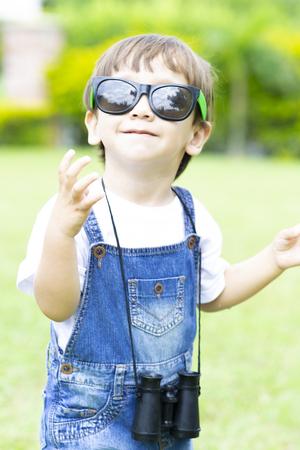 Happy Boy Playing, Enjoying  with Binoculars Outdoors