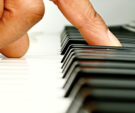 Image of a fantastic piano player playing a chord in a concert hall in London Stock Photo