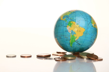 image of globe with money on shiny surface with a white background