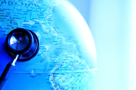 Image of a stethoscope with globe isolated on a blue background