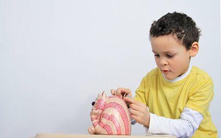 little boy saving money for the future stock photo Stock Photo