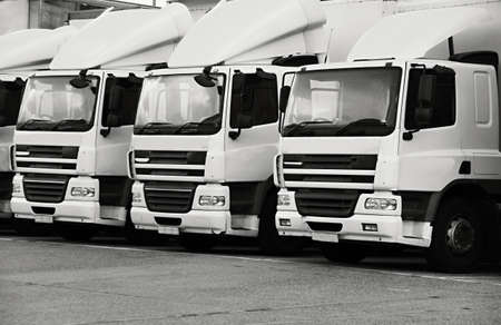 lorries parked up outside a company's car parking area ready to deliver goods to customers no people stock photo
