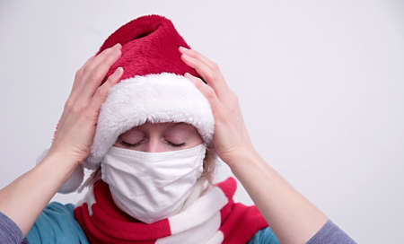 woman with mask and Christmas hat praying to god with white background stock photo