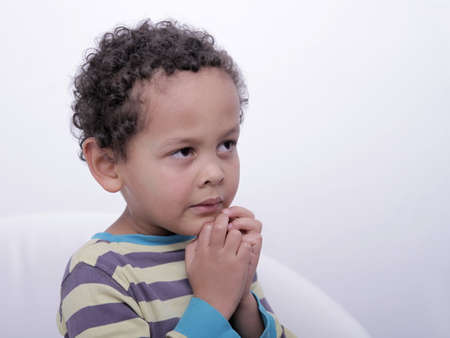 little boy praying to God with hands together pray in silence stock image stock photo