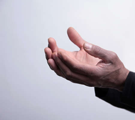 man praying to god with hands together on grey background stock image stock photo