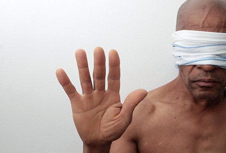 black men blindfolded black live matter after being discriminated on white background stock photo Imagens