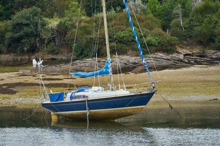 Sailboat at low tide.