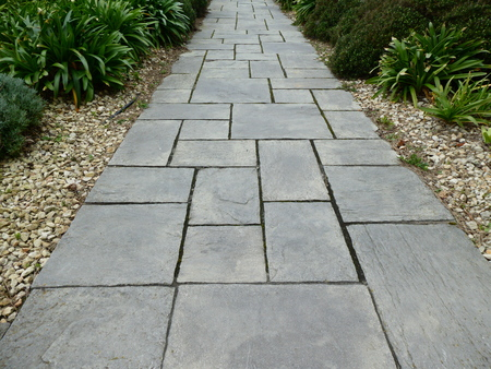 Garden path covered with slate slabs Banco de Imagens