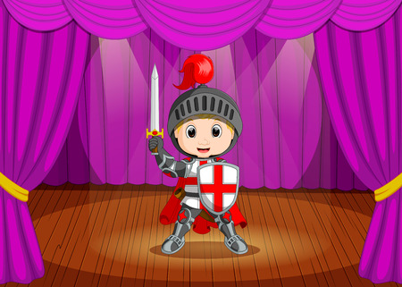 cute little boy wearing knight  costume on stage Stock Photo