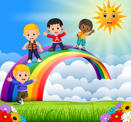 Happy kids standing over the rainbow